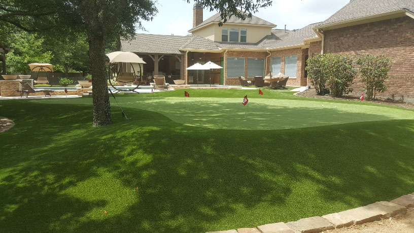 private putting green in backyard of home