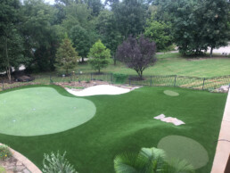 synthetic grass putting green with landscaping